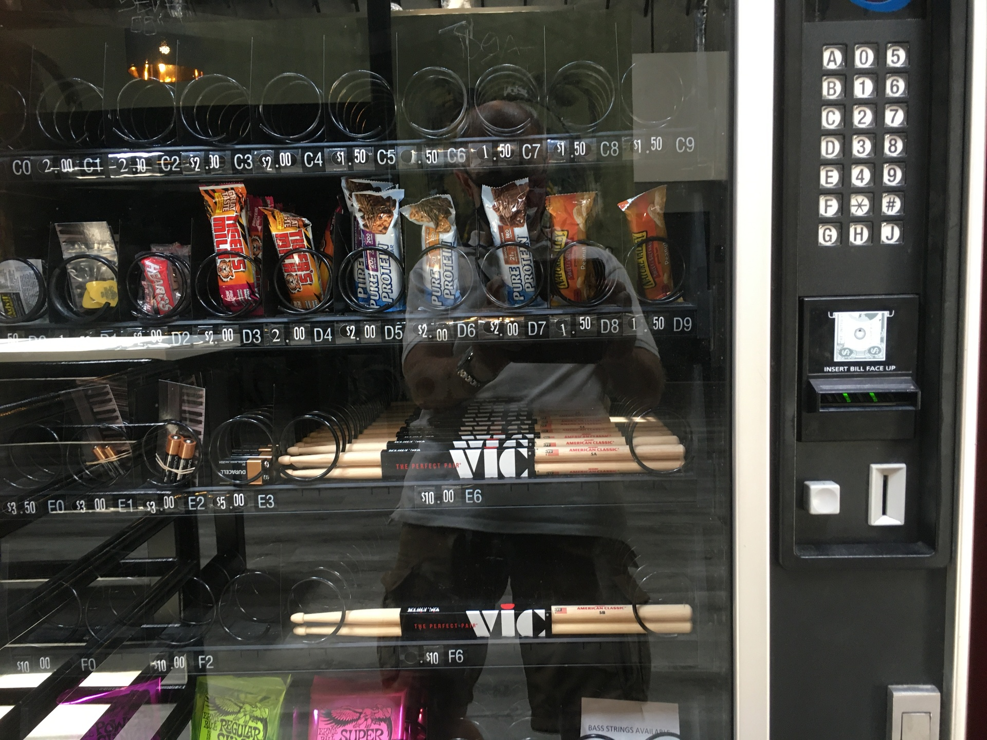 vending machine with drumsticks in it
