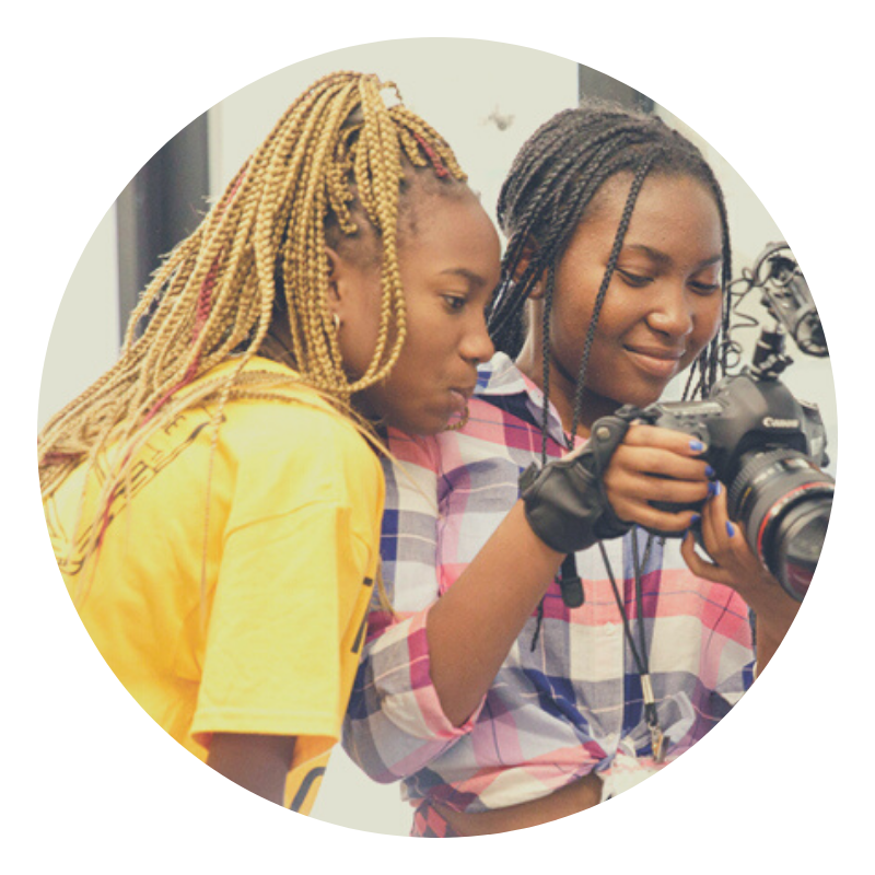 two African-American girls holding a camera
