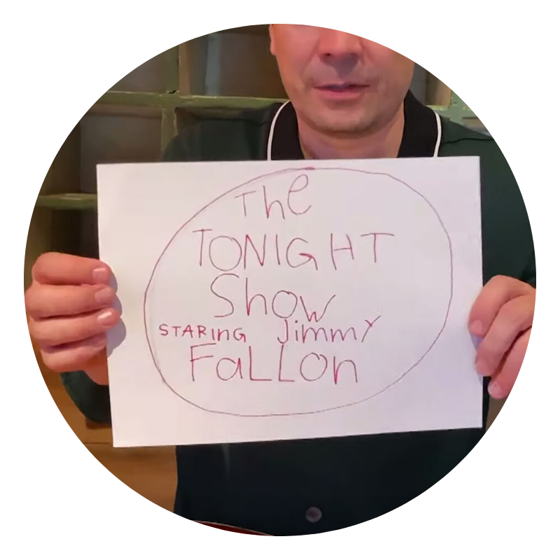 jimmy fallon holding up a hand drawn tonight show logo