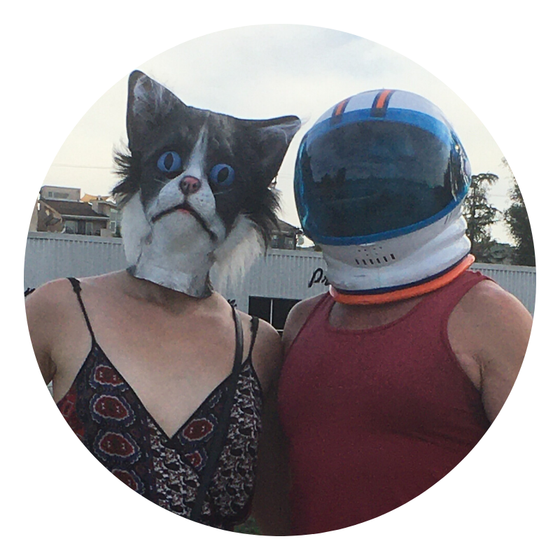 a woman with a cat mask and a man with an astronaut mask
