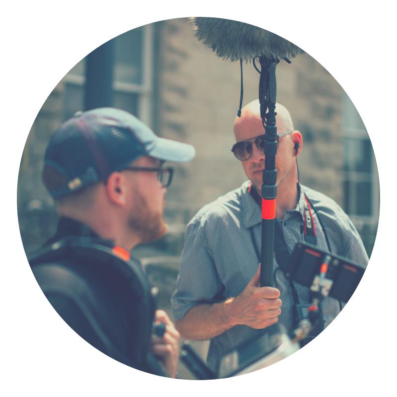 two men holding sound equipment
