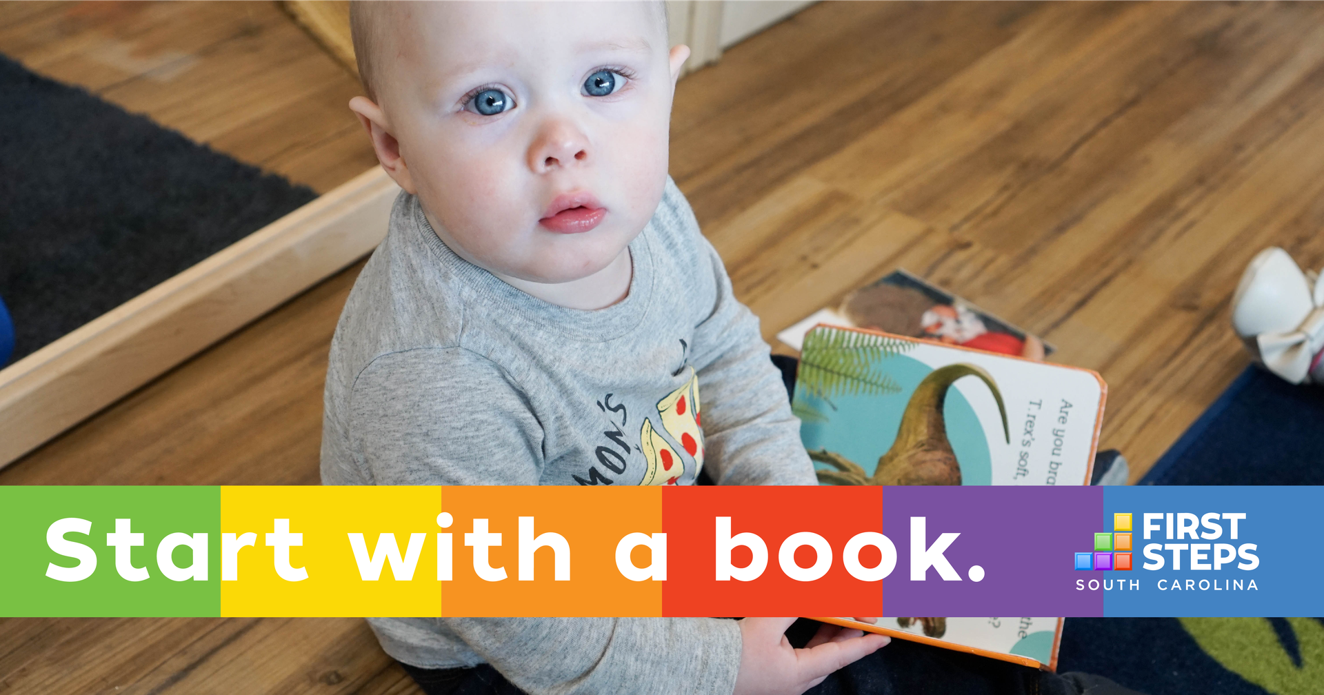 Baby holding a book