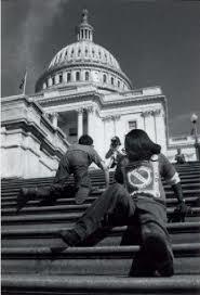 child crawling up senate stairs