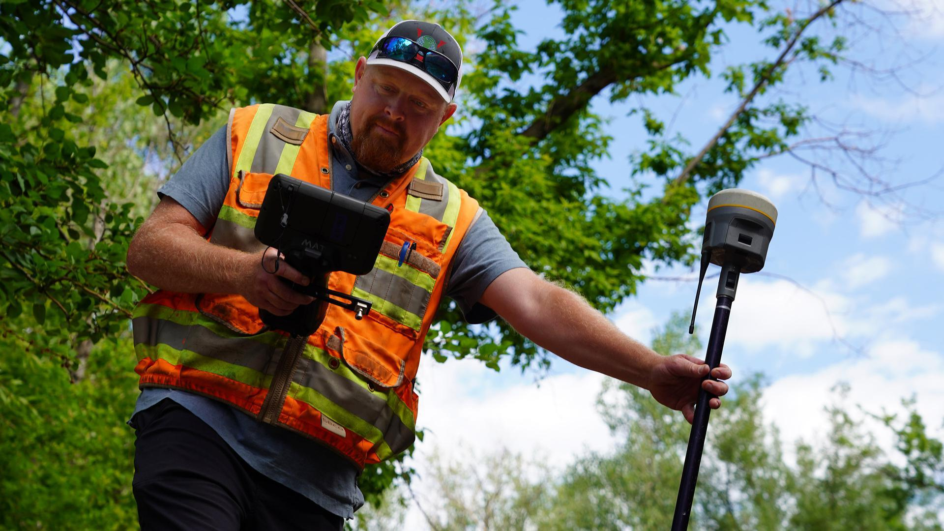 Surveyor using TSC7 with a Trimble R12i GNSS Receiver