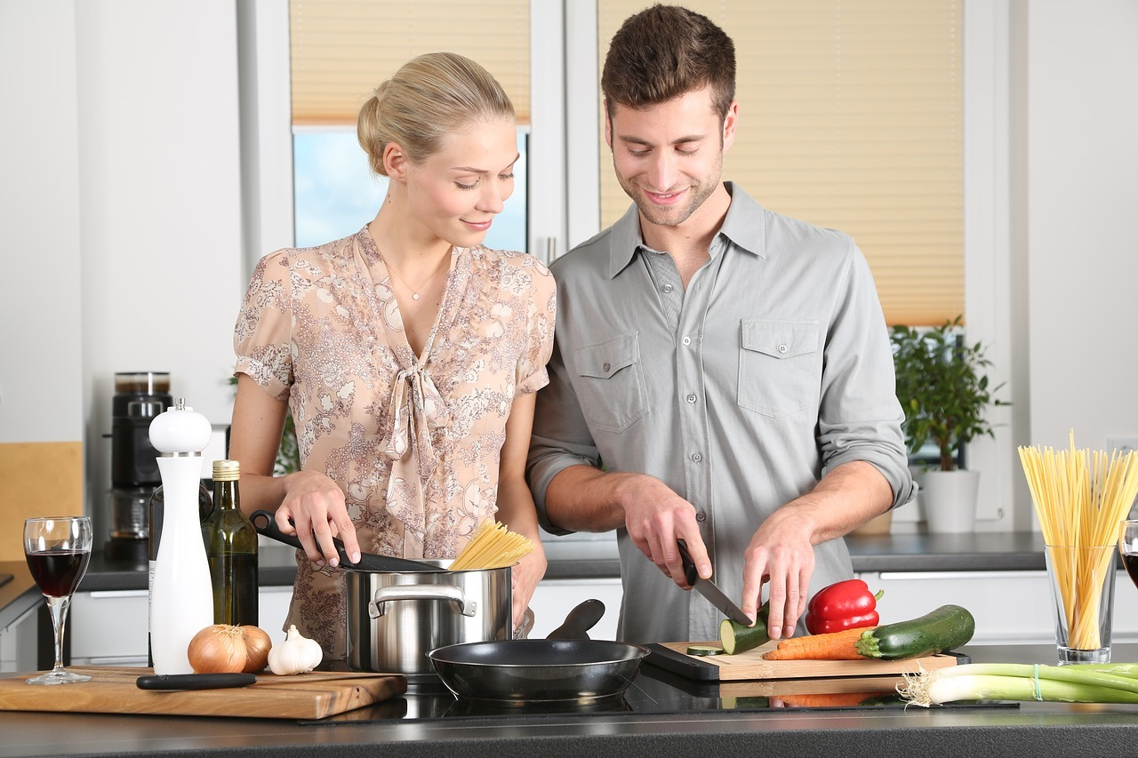 image of couple cooking together